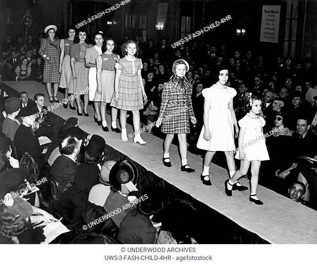 New York, New York: January 17, 1939 Young models wearing the latest in spring styles at the children's fashion show at the Hotel Pennsylvania
