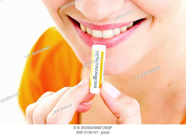 HOMEOPATHY, WOMAN Model. Oscillococcinum is a homeopathic drug used for the prevention and treatment of flu-like symptoms