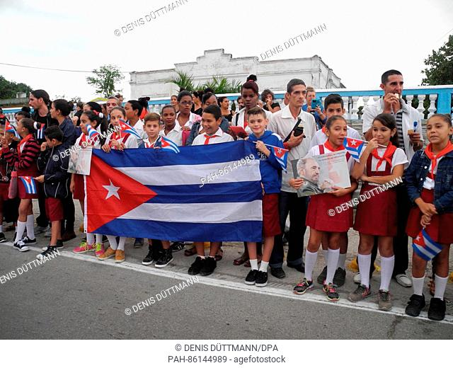Cubans line the street to honour the recently deceased revolutionary leader of the small Caribbean island Fidel Castro in Santa Clara, Cuba, 01 December 2016