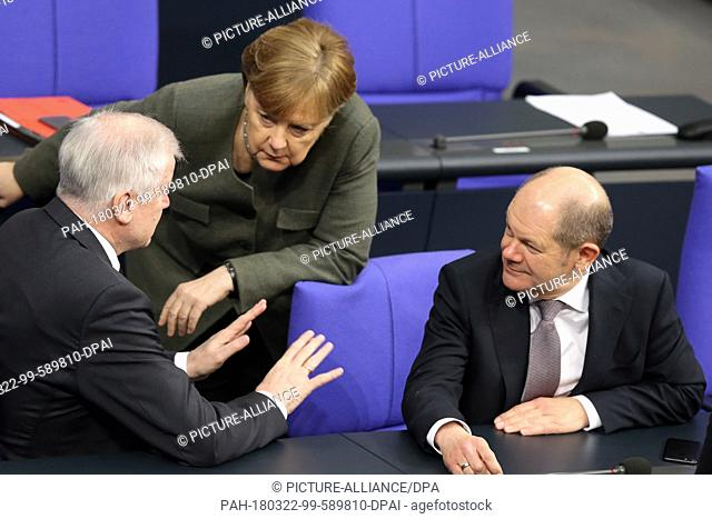 22 March 2018, Germany, Berlin: Minister for Finance from the Social Democratic Party (SPD), Olaf Scholz (R), Minister for Internal Affairs and Building from...