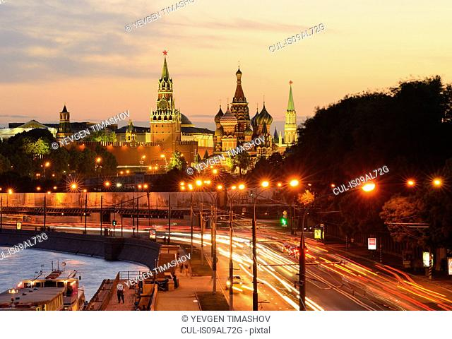 View of Kremlin towers, Saint Basils Cathedral and city highway at night, Moscow, Russia