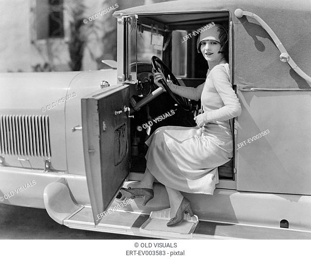 Portrait of woman in car All persons depicted are not longer living and no estate exists Supplier warranties that there will be no model release issues