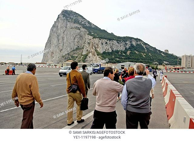 Tourists on the tarmac at Gibraltar Airport, heading towards the Rock of Gibraltar, Gibraltar, British Overseas Territory, England