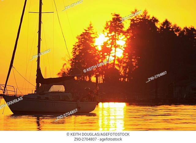 Sailboat at sunrise, Departure Bay, Nanaimo, Vancouver Island, British Columbia