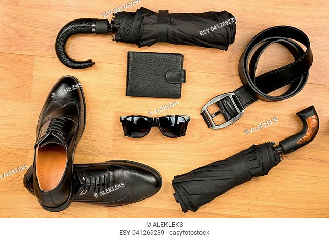 Set of men's fashion accessories lying on the laminate. View from above