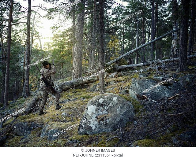 Man hunting in forest