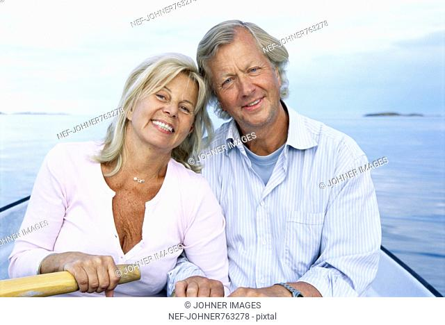 Senior couple in a rowboat, Sweden