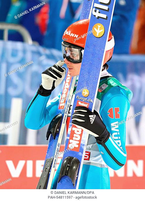 Richard Freitag ofGermany reacts during the fourth stage of the 63rd Four Hills Tournament ski jumping event in Bischofshofen, Austria, 06 January 2015