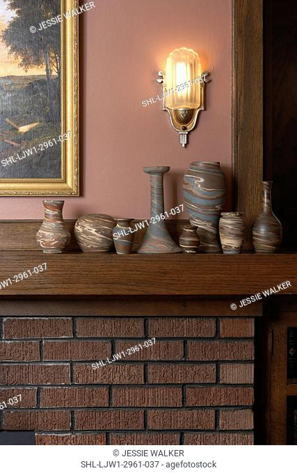 LIVING ROOM: Arts and Crafts style home, fireplace detail, oak mantel with Nioloak art pottery, wall sconce