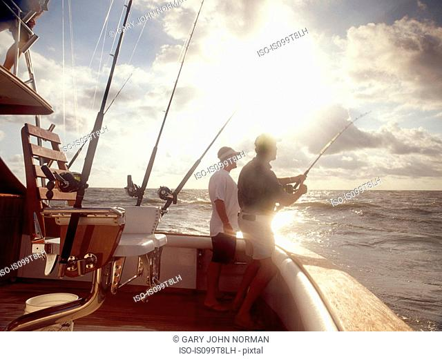 Men fishing from sport fishing boat