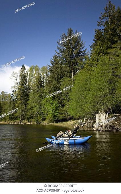 A flyfisherman on the Salmon River, Sayward, Northern Vancouver Island, British COlumbia, Canada