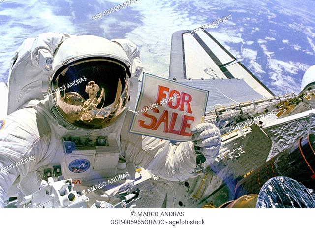 an astronaut holding a for sale plate