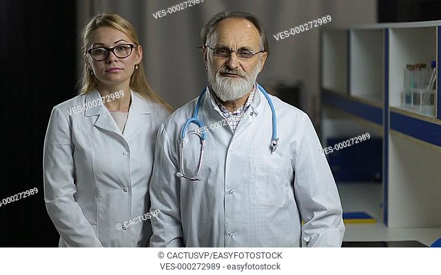 Portrait of smiling doctos in hospital office