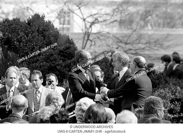 Washington, D. C. : March 26, 1979. President Jimmy Carter shaking hands with Egyptian President Anwar Sadat and Israeli Prime Minister Menachem Begin at the...
