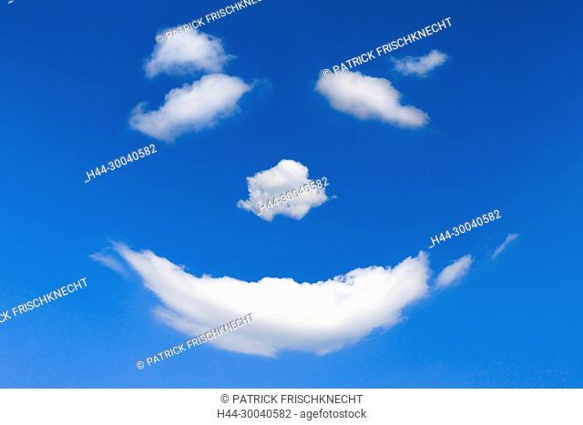 Wolken Gesicht am blauen Himmel