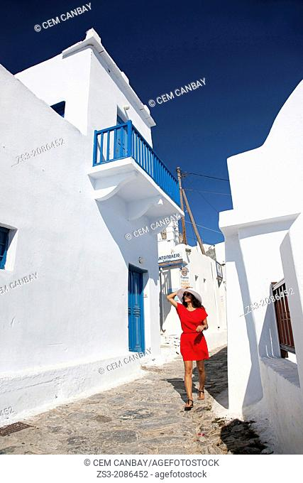 Woman having a walk in town center, Amorgos, Cyclades Islands, Greek Islands, Greece, Europe