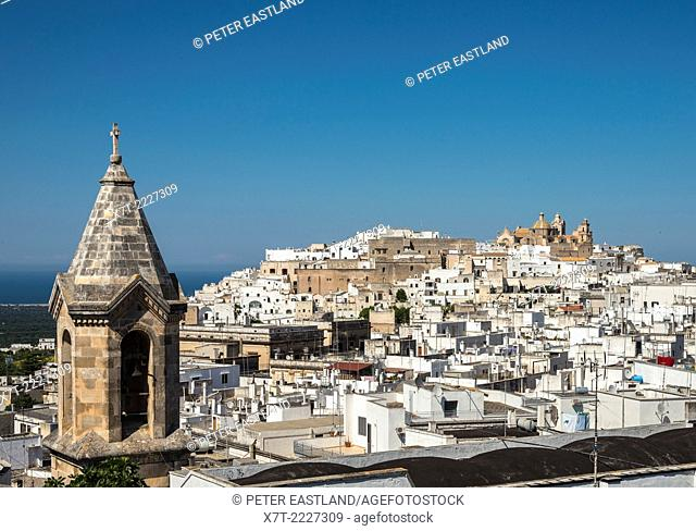 Looking across the rooftops towards the 15th cen. cathedral at Ostuni, Puglia, Italy