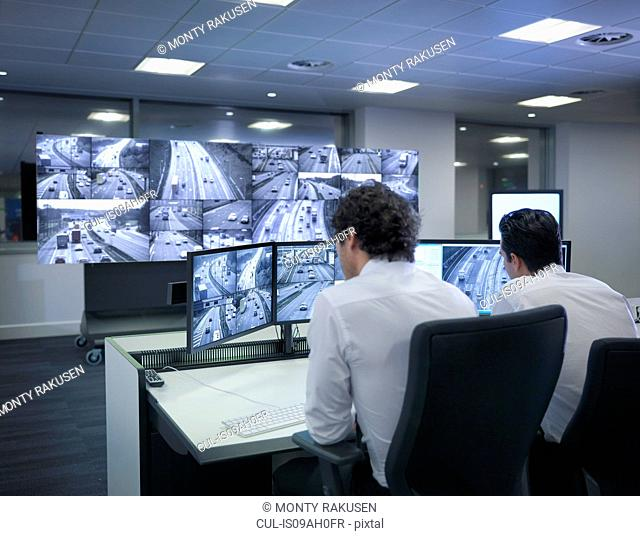 Operators with screens in traffic control room