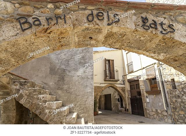 Street view,ancient houses, arch sign in catalan language Barri dels Gats, neighborhood cats,Piera,province Barcelona,Catalonia,Spain