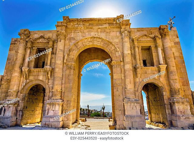 Hadrian's Arch Gate Sun Ancient Roman City Jerash Jordan. Jerash came to power 300 BC to 100 AD and was a city through 600 AD