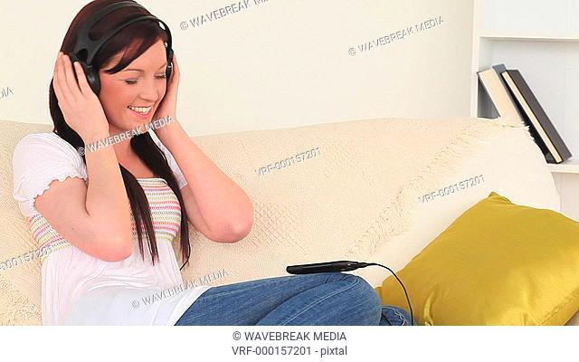 Dark-haired woman listening to music