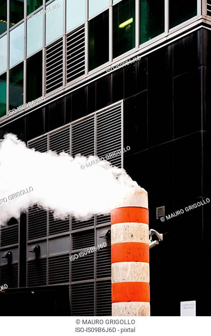 Striped smoke stack and office exterior, Times Square, New York, USA