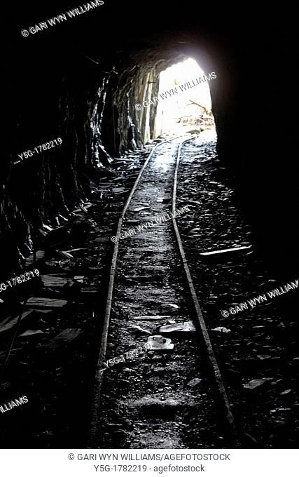 dark tunnel in slate quarry in wales