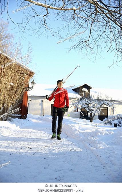 Man walking in ski resort