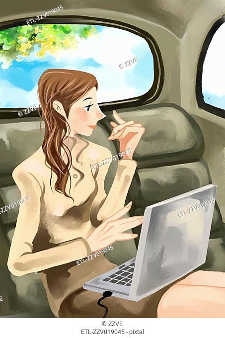 Businesswoman using laptop in backseat of vehicle