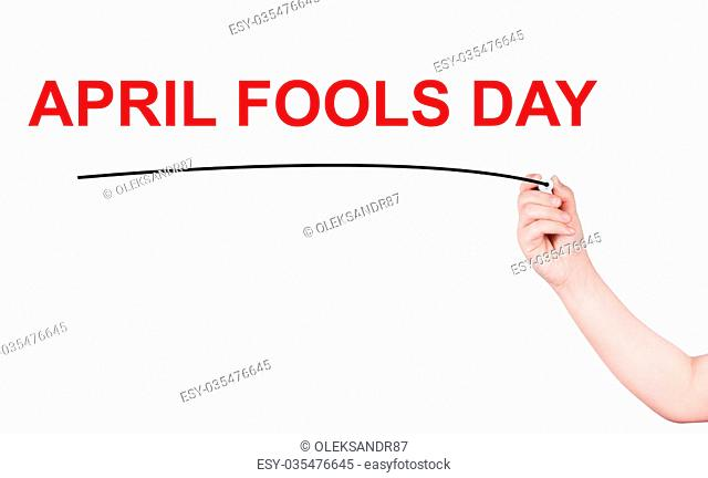 April fools day word write on white background by woman hand holding highlighter pen