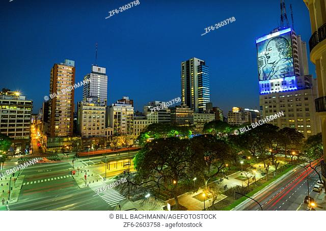 Buenos Aires Argentina 9 de Julio Avenue the widest street in the world with traffic at night twilight next to Lima Avenue with traffic blurs of lights and Eva...