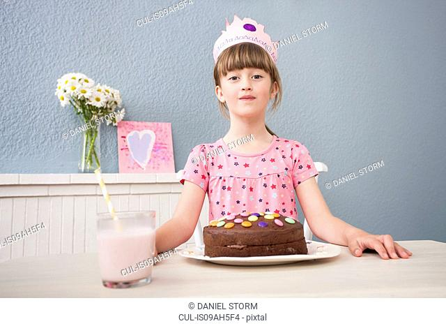 Girl with her birthday cake