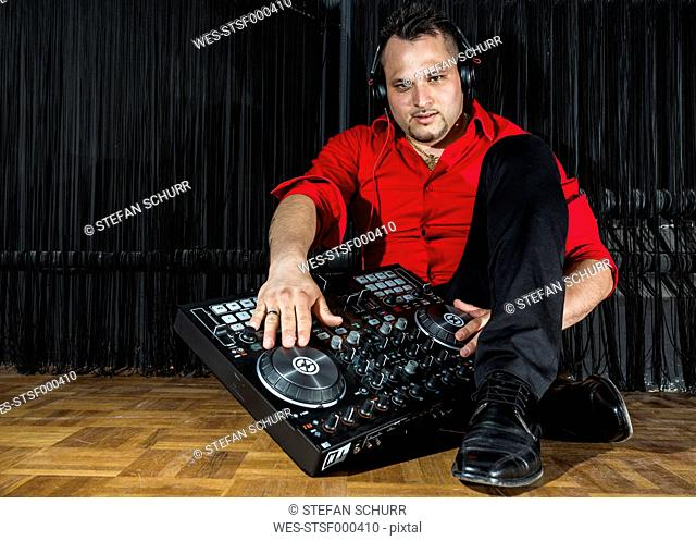 Germany, Cuban DJ with mixing console