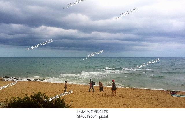 Storm clouds over the beach. Caldes d'Estrac. Maresme, Barcelona province, Catalonia, Spain