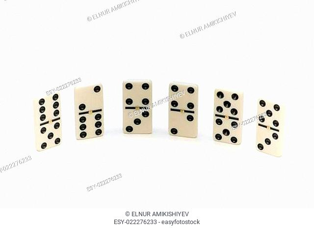 Various domino pieces isolated on the white
