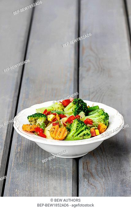 Fresh vegetable salad in ceramic bowl
