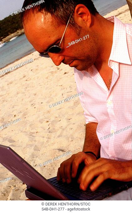 Man with Laptop at the Beach