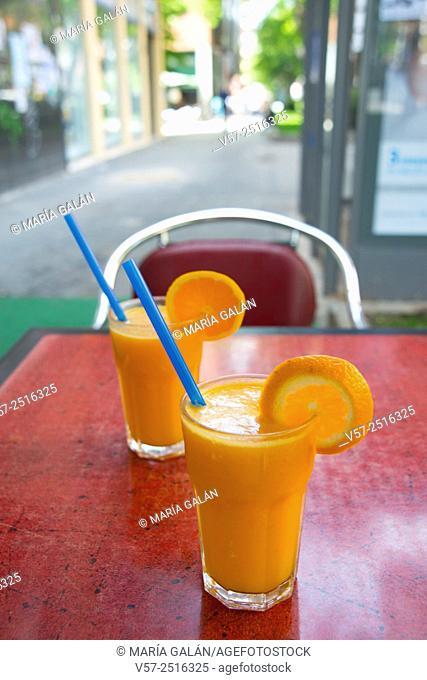 Two glasses of orange juice in a terrace. Madrid, Spain