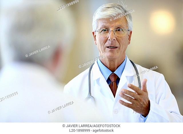 Doctor with stethoscope talking with patient, Onkologikoa Hospital, Oncology Institute, Case Center for prevention, diagnosis and treatment of cancer, Donostia