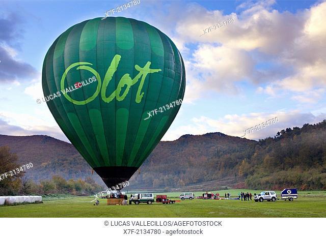 Hot air balloon preparing for flight over Garrotxa Natural Park,Girona province. Catalonia. Spain