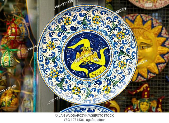 A Trinacria, triskelion ancient symbol or emblem of Sicily, painted on the traditional suvenire ceramic plate, Taormina, Sicily, Italy