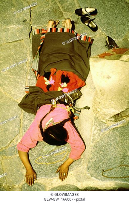 High angle view of a worshipper praying in a temple, Jokhang temple, Lhasa, Tibet, China