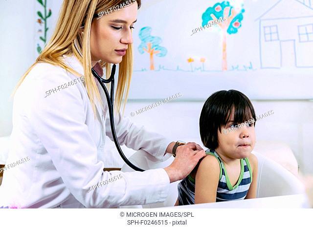 Paediatrician examining boy with stethoscope