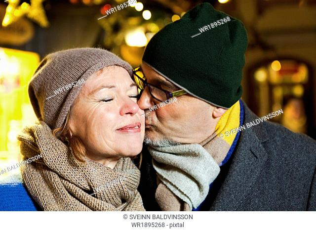 Senior couple at Christmas market, Bad Toelz, Bavaria, Germany