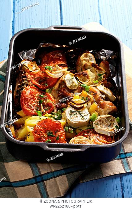 Oven tray with baked chicken with vegetables