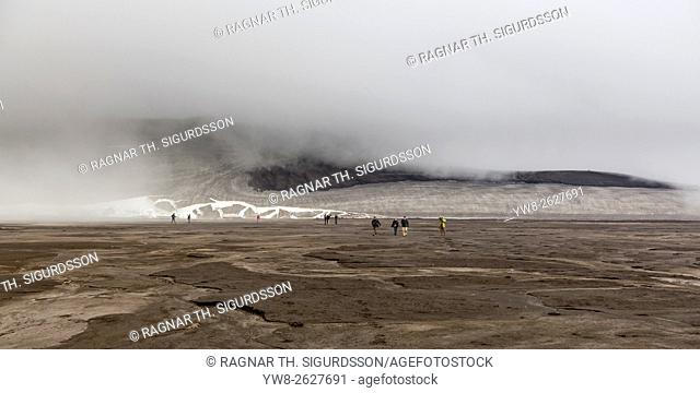 People exploring the landscape after eruption from Eyjafjallajokull Volcano, Fimmvorduhals, Iceland