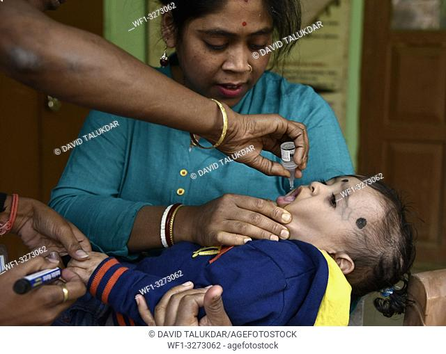 Guwahati, Assam, India. March 10, 2019. An Indian child receives polio vaccine drops on National Immunisation Day in Guwahati