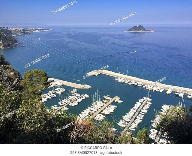 Italy, Liguria, Alassio, Punta Santa Croce, Harbour background Gallinara Island. . .