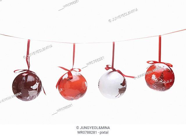 The red Christmas ball decorations hung upon the red string