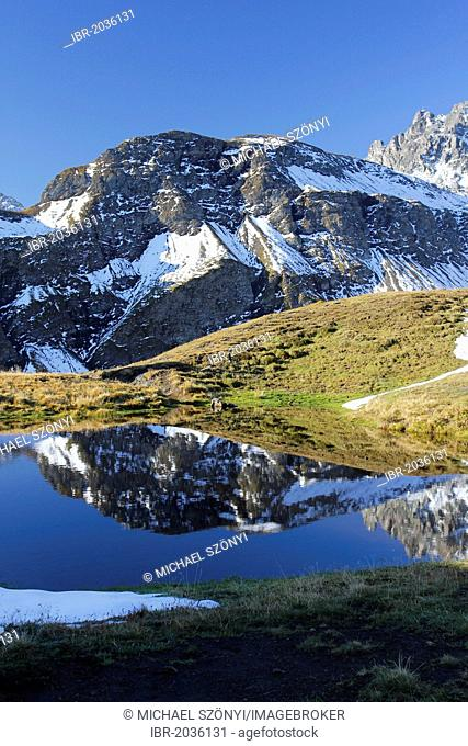 Pizol Mountain with reflection in the water, Canton of St. Gallen, Switzerland, Europe, PublicGround